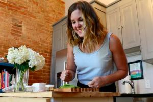 DENVER, CO - JULY 30: Kate Michalowski reads over the instructions for one of the dinners from her box from Green Chef on July 30, 2015 at her home. Green Chef is one of the food delivery services in the Denver area which many have options for athletes and people with special diets. (Photo By Brent Lewis/The Denver Post)