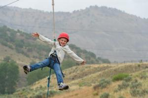 Camper Madison Stanley catches air on the challenge course at Roundup River Ranch in Avon, Colorado, in 2014. (Photo by William R. Edwards, provided by Roundup River Ranch)